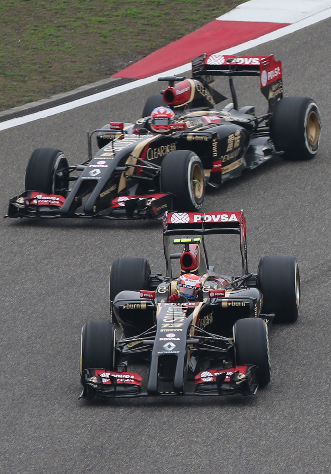 Photo - Lotus driver Romain Grosjean of France, top, and his teammate driver Pastor Maldonado of Venezuela, bottom, drive during the practice session for Sunday's Chinese Formula One Grand Prix at Shanghai International Circuit in Shanghai, Friday, April 18, 2014. (AP Photo/Eugene Hoshiko)