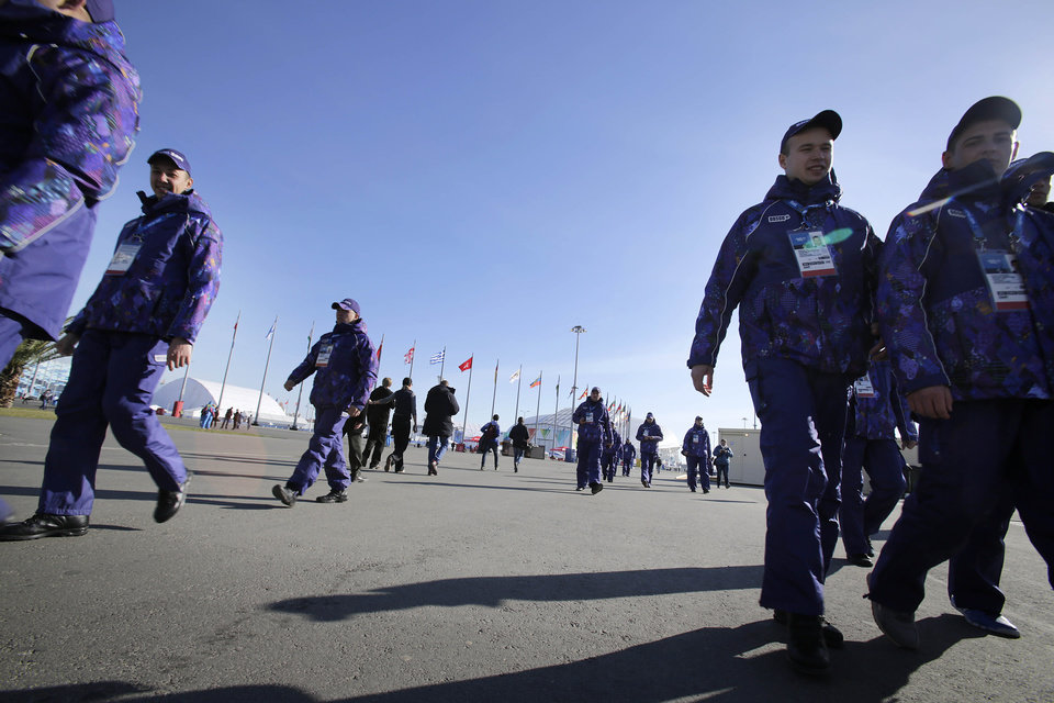 Photo - Russian security personnel dressed in Olympic track suits arrive for duty ahead of the 2014 Winter Olympics opening ceremony, Friday, Feb. 7, 2014, in Sochi, Russia. (AP Photo/Wong Maye-E)