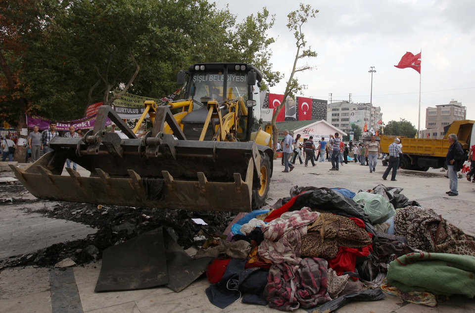 Photo - A bulldozer cleans the entrance of Gezi Park from debris in Istanbul, Saturday, June 15, 2013. Protesters will press on with their sit-in at an Istanbul park, an activist said Saturday, defying government appeals and a warning from Prime Minister Recep Tayyip Erdogan for the two-week standoff that has fanned nationwide demonstrations to end. (AP Photo/Thanassis Stavrakis)