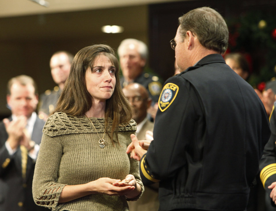 Elke Meeus received her late husband's police badge from Police Chief Bill Citty in a ceremony on Dec. 6, 2012. Her husband, police recruit Kelley Chase, died after a training accident. File photo By David McDaniel/The Oklahoman     loc-boxscoren11 <strong>David McDaniel - The Oklahoman</strong>