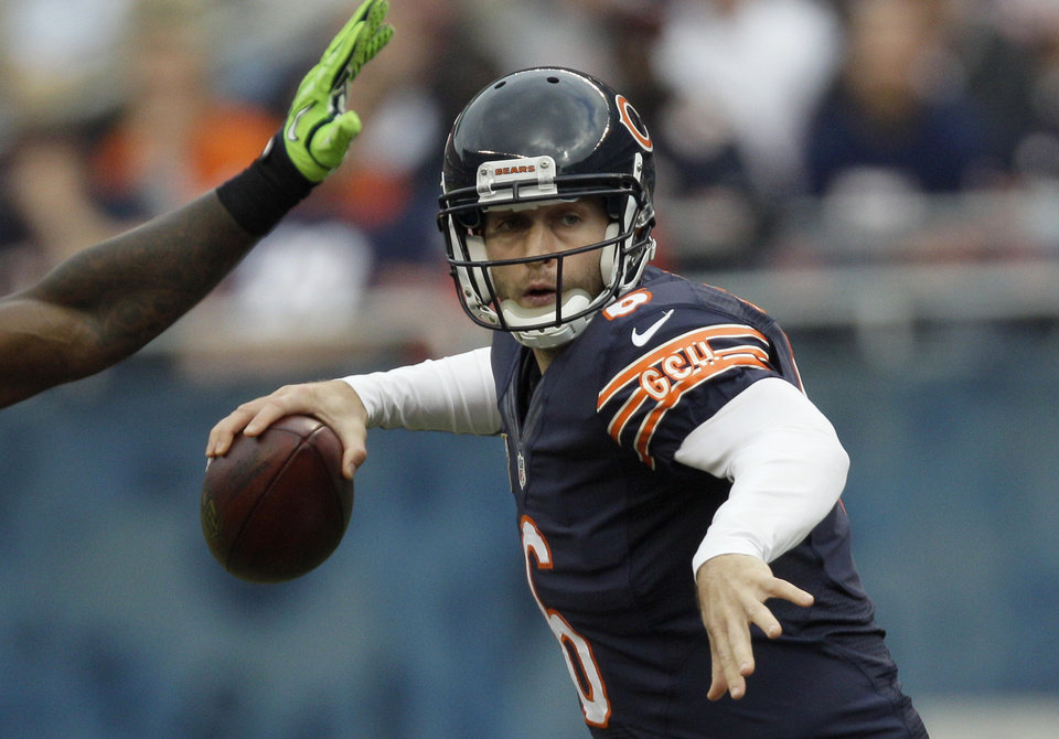 Photo - Chicago Bears quarterback Jay Cutler (6) passes against the Seattle Seahawks in the first half of an NFL football game in Chicago, Sunday, Dec. 2, 2012. (AP Photo/Nam Y. Huh)