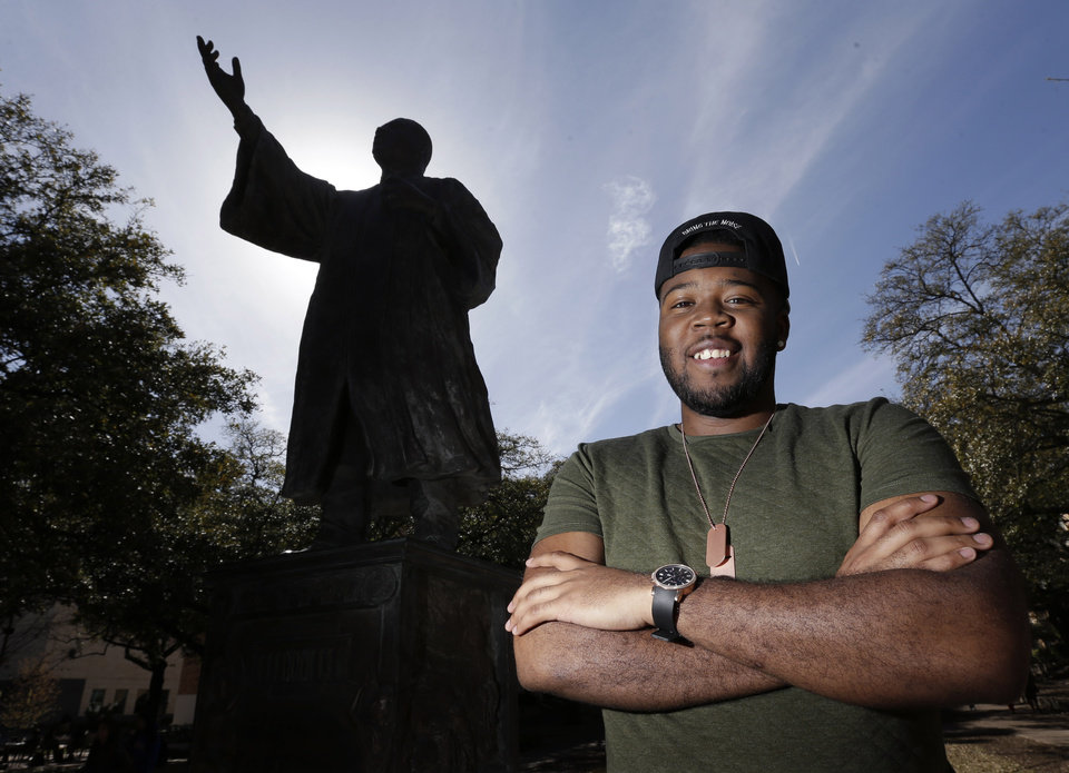 In this March 5, 2013 photo, University of Texas senior Bradley Poole poses for a photo on campus near the Martin Luther King Jr. statue in Austin, Texas. Poole, an advertising major, became president of the school\'s Black Student Alliance, seeking camaraderie after noticing he often was the only African-American in his classes. In two pivotal legal cases, one on affirmative action and another on voting rights, a divided U.S. Supreme Court may be poised in the coming weeks to rule that racism is largely a relic of America\'s past. The question is apt as the nation nears a demographic tipping point, when non-whites become the country\'s majority for the first time. (AP Photo/Eric Gay)