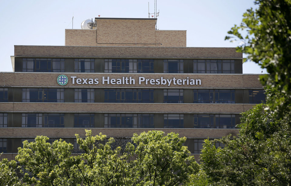 Photo - The Texas Health Presbyterian Hospital in Dallas is seen Tuesday Aug. 6, 2013.  Former President George W. Bush underwent a heart procedure at the hospital Tuesday after doctors discovered a blockage in an artery. Bush spokesman Freddy Ford says a stent was inserted during the procedure. (AP Photo/Tony Gutierrez)