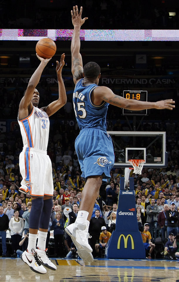 Photo - Oklahoma City's Kevin Durant (35) takes the final shot of regulation as Trevor Booker (35) of Washington defends during the NBA basketball game between the Washington Wizards and the Oklahoma City Thunder at the Oklahoma City Arena in Oklahoma City, Friday, January 28, 2011. Durant missed the shot. The Thunder won, 124-117, in double overtime. Photo by Nate Billings, The Oklahoman