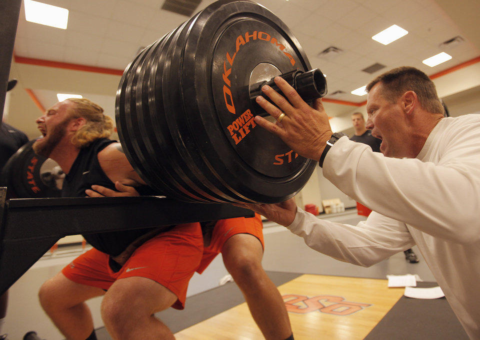 Photo - OKLAHOMA STATE UNIVERSITY / COLLEGE FOOTBALL: Rob Glass, strength and conditioning coach, coaches Evan Epstein, senior, during the OSU football team's strength and conditioning training at Boone Pickens  Stadium in Stillwater, Okla., Tuesday, July 17, 2012.  Photo by Garett Fisbeck, The Oklahoman