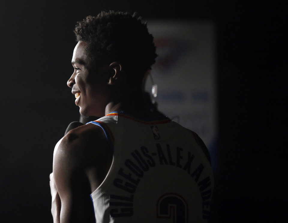 Photo - Oklahoma City's Shai Gilgeous-Alexander smiles while being interviewed during media day for the Oklahoma City Thunder NBA basketball team at Chesapeake Energy Arena in Oklahoma City, Monday, Sept. 30, 2019. [Nate Billings/The Oklahoman]