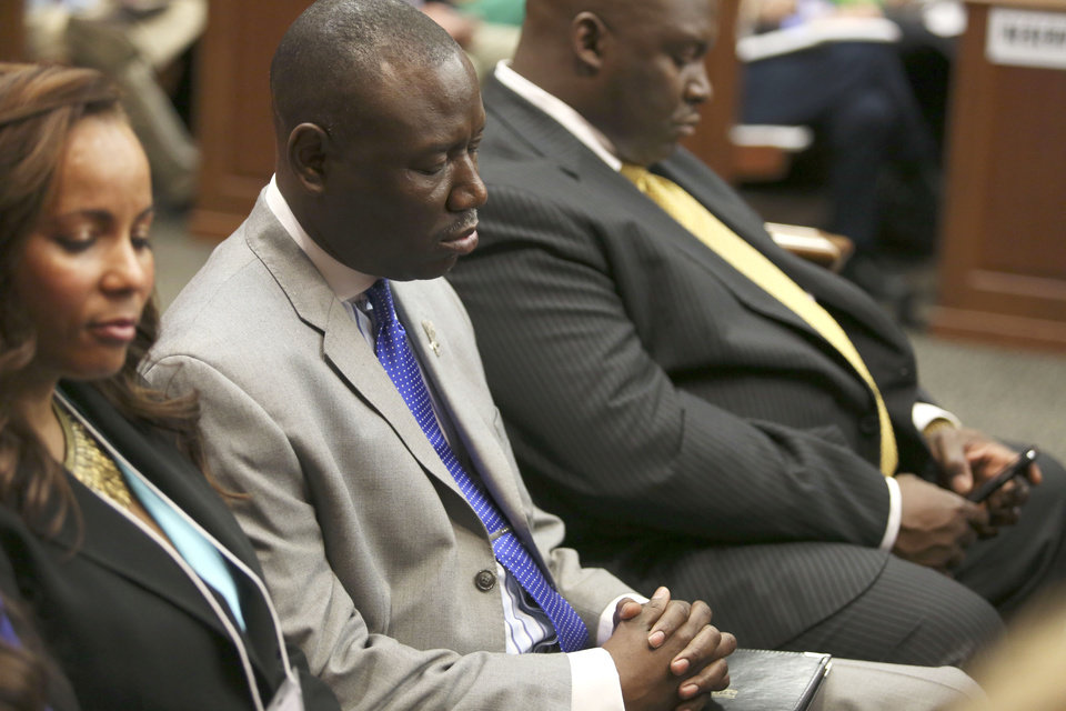 Photo - Attorneys Natalie Jackson, Benjamin Crump, and Daryl Parks, from left, sit in for the Trayvon Martin family during George Zimmerman's trial in Seminole circuit court in Sanford, Fla. on Saturday, July 13, 2013. Jurors found Zimmerman not guilty of second-degree murder in the fatal shooting of 17-year-old Martin in Sanford, Fla. The six-member, all-woman jury deliberated for more than 15 hours over two days before reaching their decision Saturday night. (AP Photo/Gary W. Green, Pool) ORG XMIT: FLJR401
