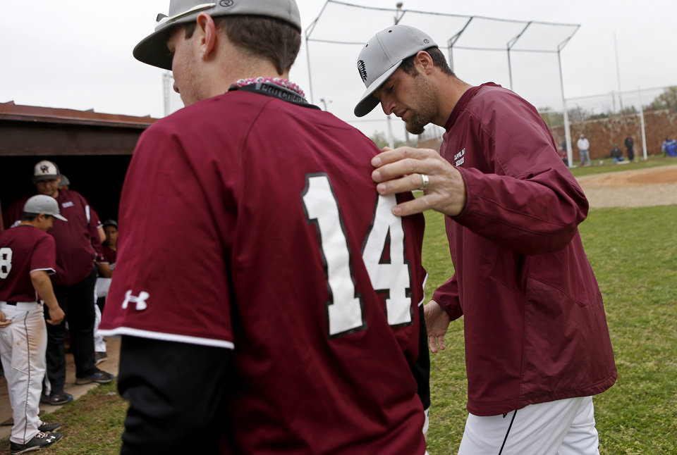 HIGH SCHOOL BASEBALL: Capitol Hill baseball coach Mike Hinckley talks with Zach Howry during a game in Oklahoma City, Tuesday, April 16, 2013. Photo by Bryan Terry, The Oklahoman