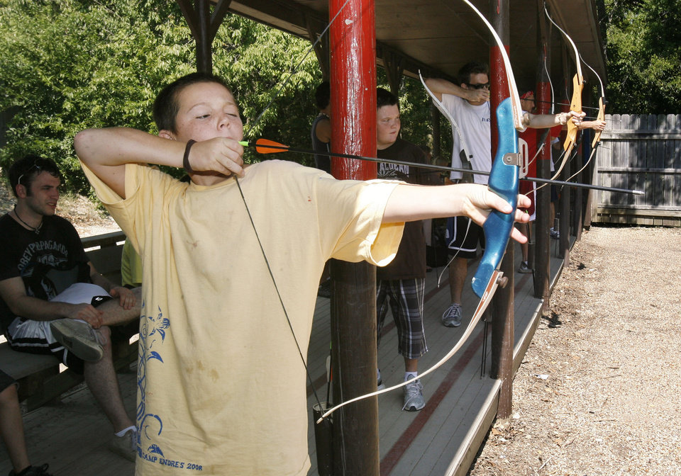 Photo - 11-year-old Colby Bradford participates in archery at Camp Endres, a diabetes camp held at Camp Classen in Davis, OK, Thursday, July 31, 2008. BY PAUL HELLSTERN, THE OKLAHOMAN ORG XMIT: KOD
