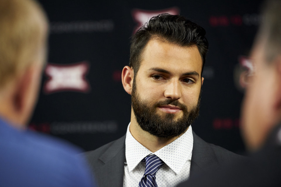Photo -  West Virginia quarterback Will Grier speaks Tuesday during Big 12 Media Days in Frisco, Texas. Grier is an early contender for the Heisman Trophy. [AP PHOTO]