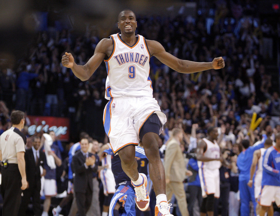 Photo - Oklahoma City's Serge Ibaka (9) reacts after the Thunder defeated Denver following the NBA basketball game between the Denver Nuggets and the Oklahoma City Thunder in the first round of the NBA playoffs at the Oklahoma City Arena, Wednesday, April 27, 2011. Photo by Sarah Phipps, The Oklahoman