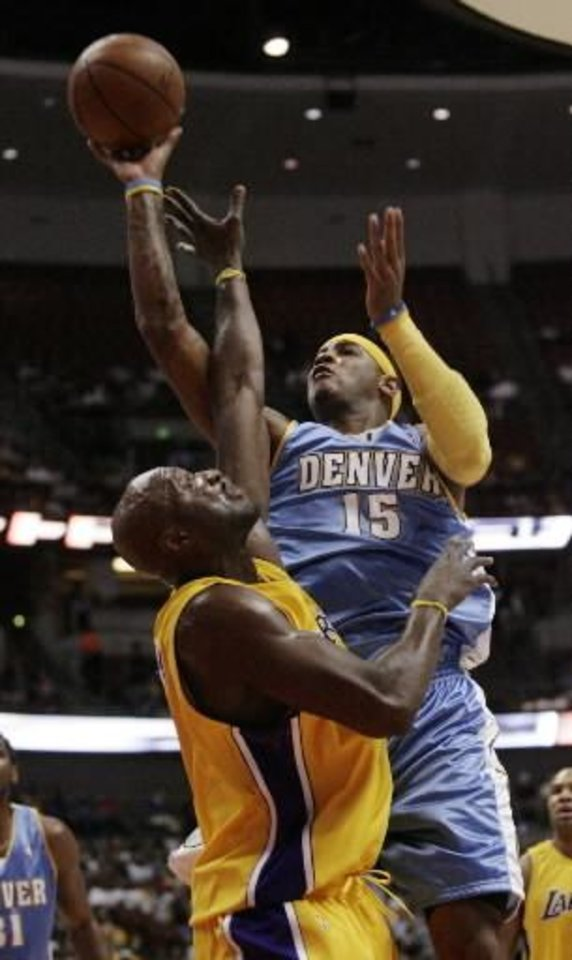 Denver Nuggets'  Carmelo Anthony, right, shoots over Los Angeles Lakers' Lamar Odom during the first half of an NBA preseason basketball game in Anaheim, Calif., on Thursday, Oct. 22, 2009. (AP Photo/Francis Specker)