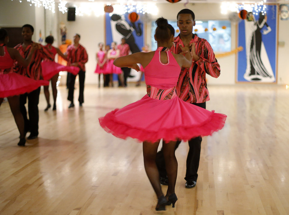 Emmett Prince, 15, and Ciarra Kelly, 15, with Life Change Ballroom Dancers, perform Friday, Oct. 19, 2012, at the Oklahoma City Swing Club. Photo by Bryan Terry, The Oklahoman <strong>BRYAN TERRY - THE OKLAHOMAN</strong>