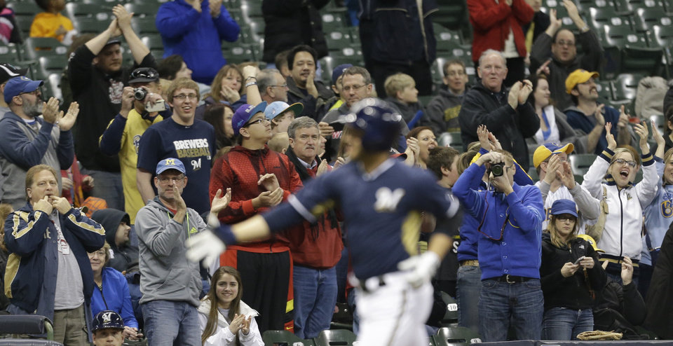 Photo - Fans cheer as Milwaukee Brewers' Ryan Braun rounds the bases after his three-RBI home run against the Kansas City Royals in the third inning of an exhibition baseball game Friday, March 28, 2014, in Milwaukee. (AP Photo/Jeffrey Phelps)