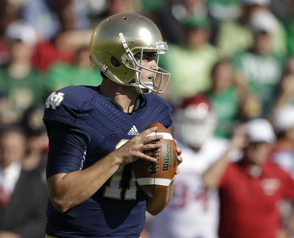 Notre Dame's Tommy Rees (11) looks to throw during the first half of an NCAA college football game against Oklahoma on Saturday, Sept. 28, 2013, in South Bend, Ind. (AP Photo/Darron Cummings)  ORG XMIT: INDC105