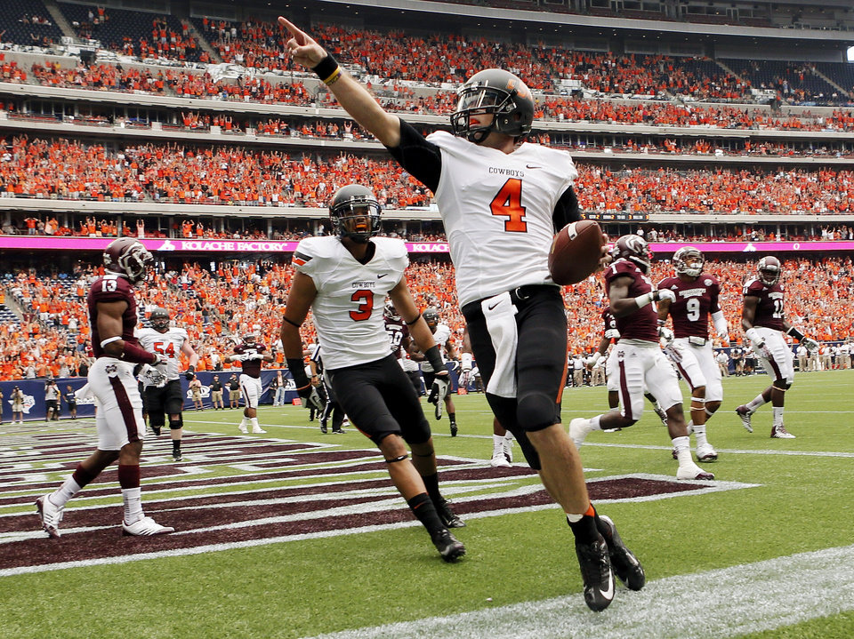 Oklahoma State\'s J.W. Walsh (4) celebrates a touchdown run near Marcell Ateman (3) in the second quarter during the AdvoCare Texas Kickoff college football game between the Oklahoma State University Cowboys (OSU) and the Mississippi State University Bulldogs (MSU) at Reliant Stadium in Houston, Saturday, Aug. 31, 2013. Photo by Nate Billings, The Oklahoman