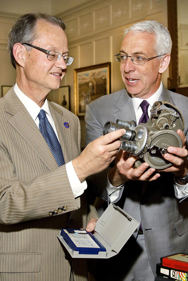 Oklahoma Historical Society Executive Director Bob Blackburn, left, examines a movie camera held by David Griffin, chairman and CEO of Griffin Communication, which donated its film and video archives to the proposed Oklahoma Museum of Popular Culture (OKPOP), to bre built in Tulsa. Photo by Jim Beckel, The Oklahoman <strong>Jim Beckel</strong>