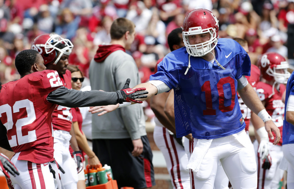 Roy Finch (22) and Blake Bell (10) shake hands before the annual Spring Football Game at Gaylord Family-Oklahoma Memorial Stadium in Norman, Okla., on Saturday, April 13, 2013. Photo by Steve Sisney, The Oklahoman