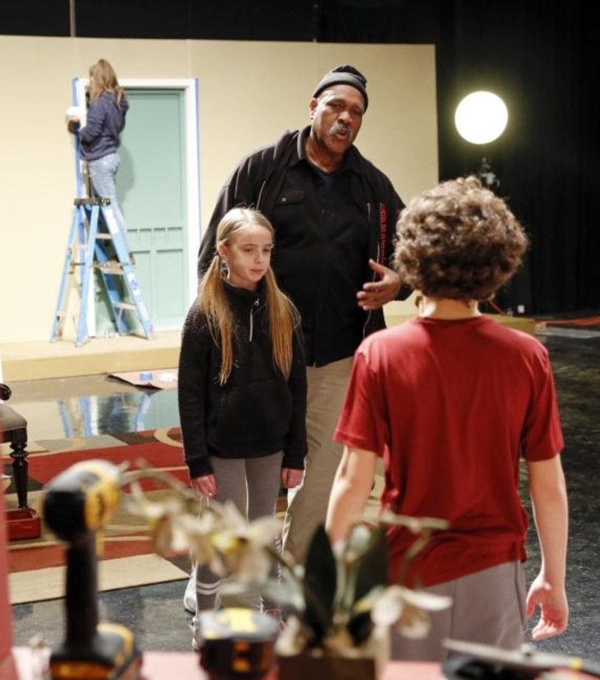 Photo -  Actors Oscar Ray, center, Lorelei Krieger, 11, left, and Jesse Kilinc, 11, rehearse a scene during preparations to film
