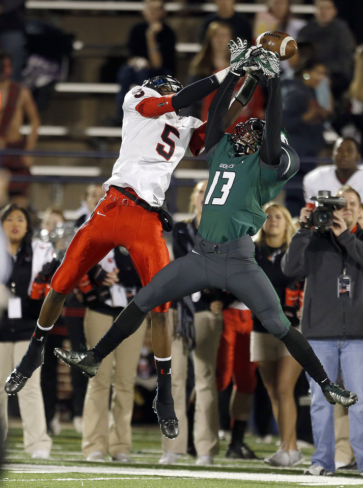 Photo - Edmond Santa Fe's Dhaniel Bly breaks up a pass intended for Union's Jeffery Mead during the high school football game between Edmond Santa Fe and Union at Wantland Stadium in Edmond, Okla.,  Friday, Nov. 16, 2012. Photo by Sarah Phipps, The Oklahoman