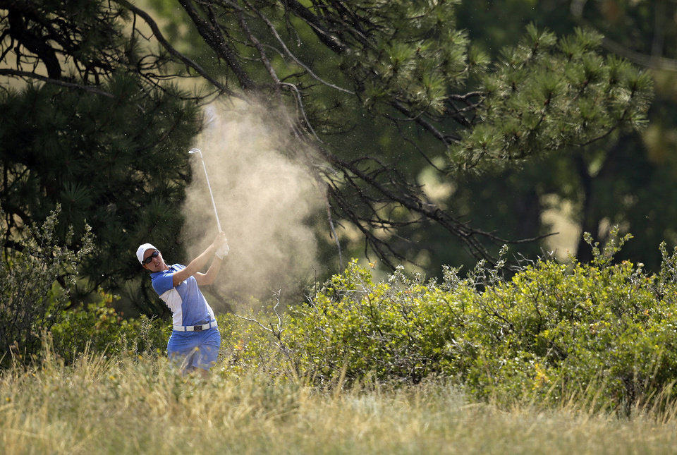 Photo - Europe's Carlota Ciganda, from Spain, hits from the deep rough on eighth hole during her the singles match against United States' Morgan Pressel at the Solheim Cup golf tournament on Sunday, Aug. 18, 2013, in Parker, Colo. (AP Photo/Chris Carlson)