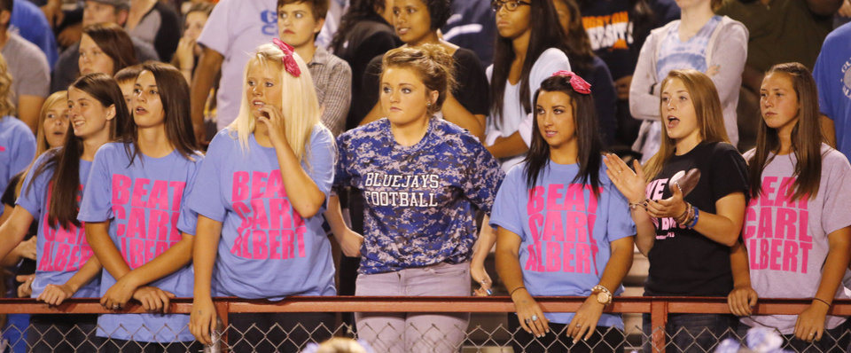 Photo - Guthrie fans watch the action during the high school football game between Guthrie at Carl Albert in Midwest City, Friday, October 11, 2013.  Photo by Doug Hoke, The Oklahoman