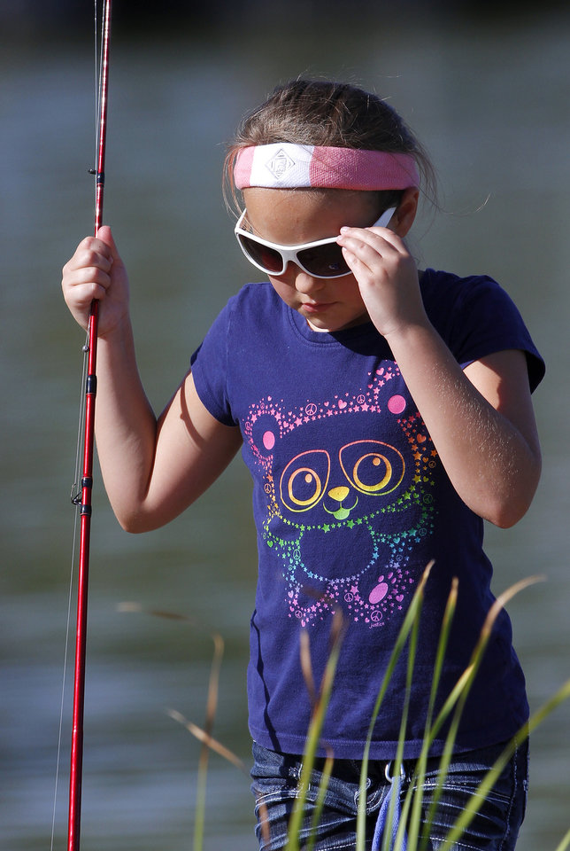 Kayla Anderson, 10, of Midwest City, was unable to snag a single fish at the clinic. The Oklahoma City Police Athletic League and the Oklahoma City  parks department teamed up to organize a fishing clinic for kids, aged  5-15, Saturday morning, July 21, 2012.  Organizers at the event said 50 children showed up to cast their fishing lines and lures into Crystal Lake on SW 15, west of MacArthur Blvd.  Most children were accompanied by an adult.   Photo by Jim Beckel, The Oklahoman.