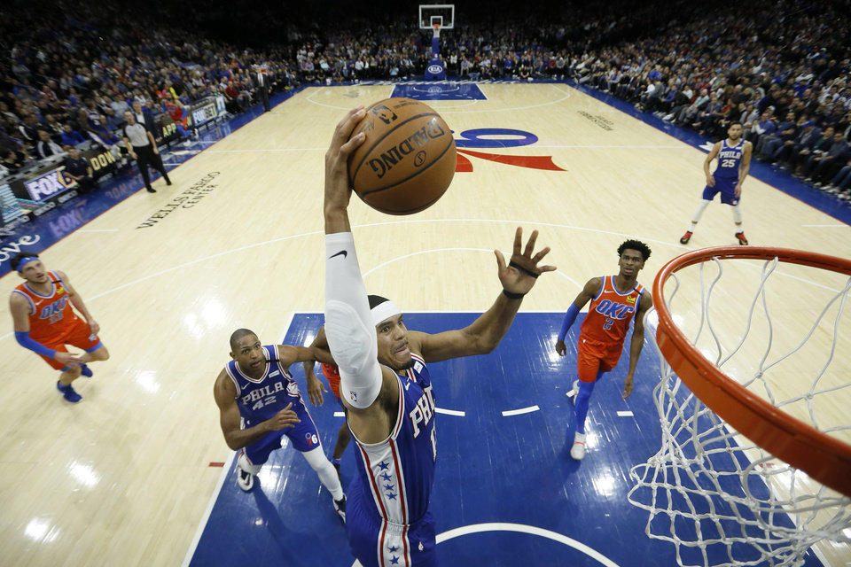 Photo - Philadelphia 76ers' Tobias Harris goes up for a dunk during the first half of an NBA basketball game against Oklahoma City Thunder, Monday, Jan. 6, 2020, in Philadelphia. (AP Photo/Matt Slocum)