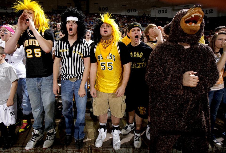 Photo - Caddo fans cheer for their team during the Class A boys basketball state tournament at the State Fair Arena in Oklahoma City, Friday, March 5, 2010.  Photo by Bryan Terry, The Oklahoman