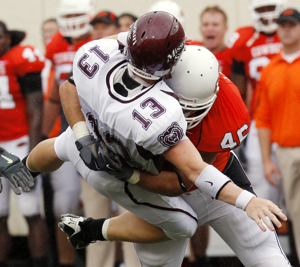 Photo - Shane Jarka hits Cody Kirby at the Oklahoma State University (OSU) football game against Missouri State University (MSU) Saturday Sept. 13, 2008 at Boone Pickens Stadium in Stillwater, Okla. BY DOUG HOKE, THE OKLAHOMAN.