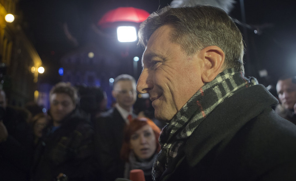 Photo - Slovenia's former prime minister Borut Pahor talks to the media outside his headquarters in Ljubljana, Slovenia, Sunday, Dec. 2, 2012.  An exit poll published by Slovenia's state television has shown that Pahor has won the presidential election in the crisis-hit EU country with 67.3 percent of the vote. (AP Photo/Darko Bandic)