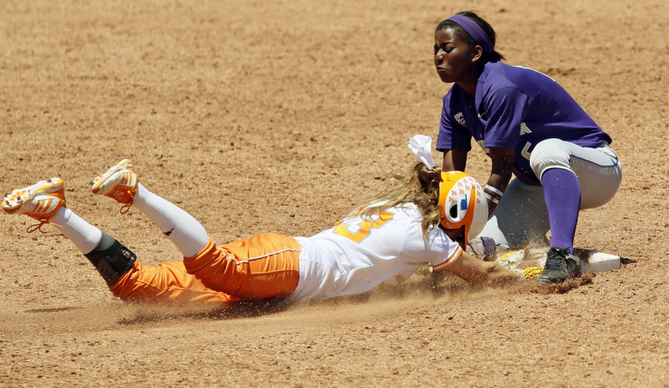 Tennessee's Kat Dotson (33) steals second base against Washington's Jennie McNeill (6) in the sixth inning during an NCAA softball game in the Women's College World Series between Washington and Tennessee at ASA Hall of Fame Stadium in Oklahoma City, Saturday, June 1, 2013. Tennessee won 1-0. Photo by Nate Billings, The Oklahoman