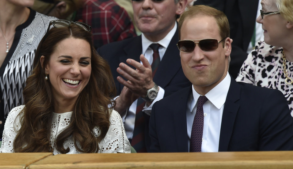 Photo - Britain's Prince William and Kate, Duchess of Cambridge watch from the Royal Box on centre court the men's singles quarterfinal match between Grigor Dimitrov of Bulgaria and Andy Murray of Britain at the All England Lawn Tennis Championships in Wimbledon, London, Wednesday July 2, 2014. (AP Photo/Toby Melville, Pool)