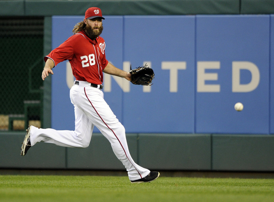 Photo - Washington Nationals right fielder Jayson Werth (28) chases after a single hit by Baltimore Orioles' J.J. Hardy during the fourth inning of a baseball game, Monday, Aug. 4, 2014, in Washington. (AP Photo/Nick Wass)