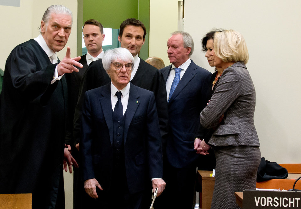 Photo - Formula One boss Bernie Ecclestone, center, arrives in the regional court in in Munich, Germany, Thursday, April 24, 2014. Ecclestone is charged with bribery and incitement to breach of trust
