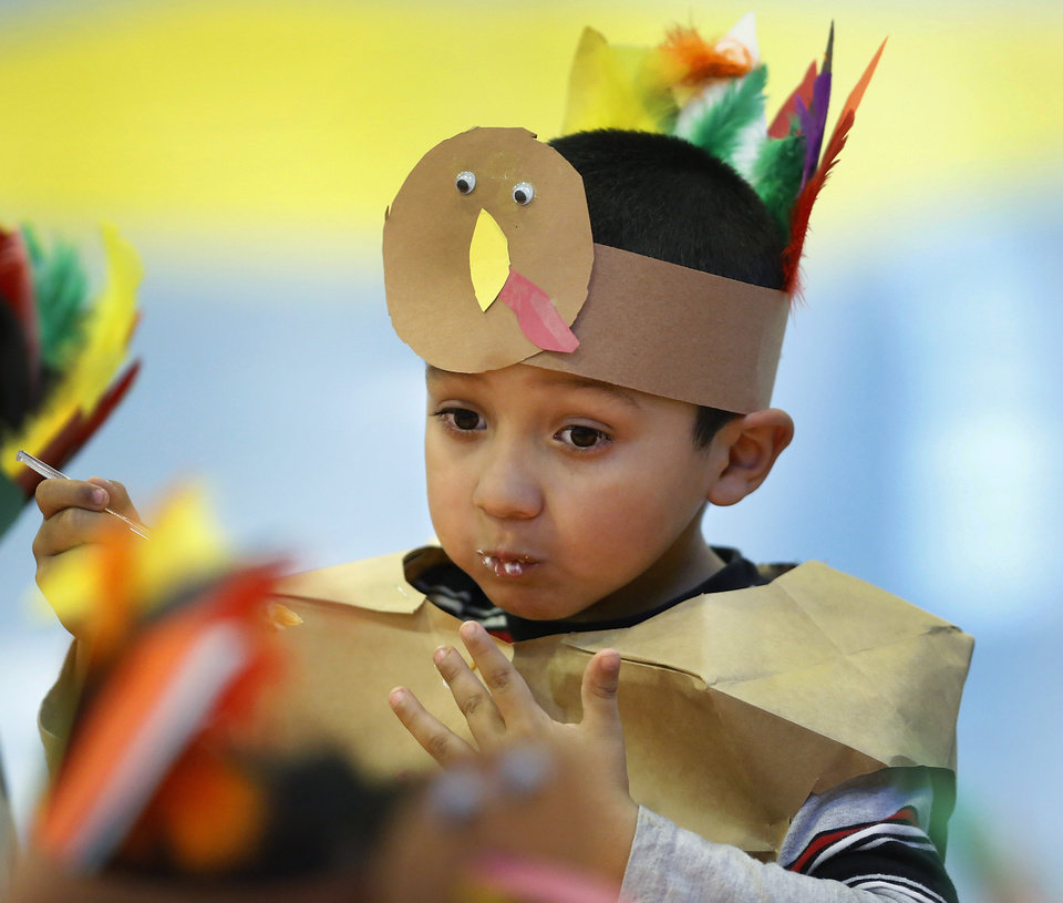 Jonathon Morales eats pie and cake. Kindergarten students at Eugene Field Elementary School in Oklahoma City have been learning about Thanksgiving traditions and the history of the national holiday in America. Their teachers helped them make paper sack vests and turkey head pieces to wear. To celebrate the end of the Thanksgiving lesson and reward the students for working so hard, about 80 students in the four kindergarten classes held a pumpkin pie break in the cafeteria Tuesday afternoon, Nov. 20, 2012. The students dressed in their creative paper sack turkey vests and head dresses. Photo by Jim Beckel, The Oklahoman