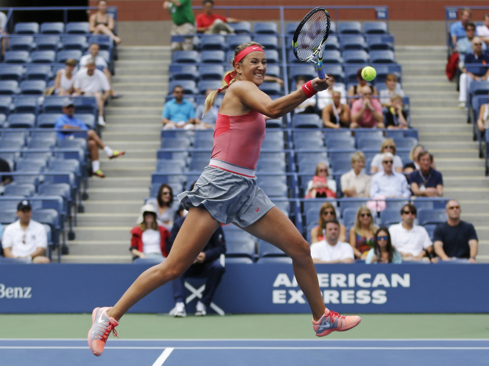 Victoria Azarenka, of Belarus, returns a shot to Victoria Azarenka, of Belarus, during the quarterfinals of the 2013 U.S. Open tennis tournament, Tuesday, Sept. 3, 2013, in New York. (AP Photo/Julio Cortez)