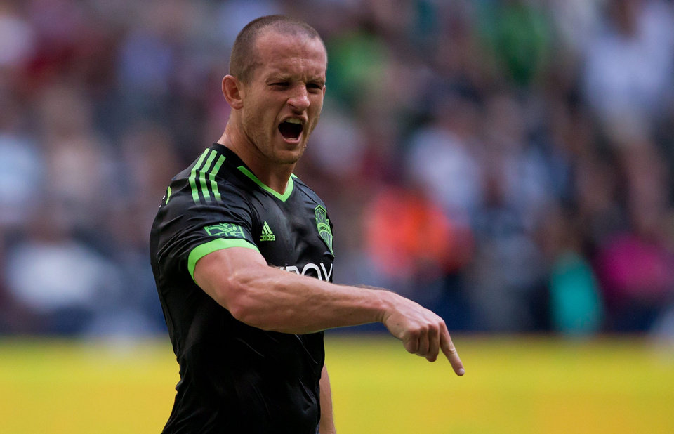 Photo - Seattle Sounders' Chad Barrett celebrates after scoring a goal against the Vancouver Whitecaps during the first half of an MLS soccer game in Vancouver, British Columbia, Saturday, May 24, 2014. (AP Photo/The Canadian Press, Darryl Dyck)