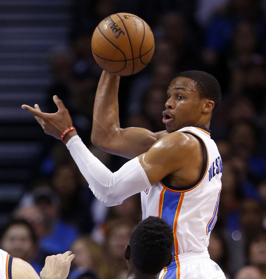 Photo - Thunder's Russell Westbrook (0) looks to pass during the NBA basketball game between the Oklahoma City Thunder and the New Orleans Pelicans at Chesapeake Energy Arena on Dec. 21, 2014 in Oklahoma City, Okla. Photo by Steve Sisney, The Oklahoman