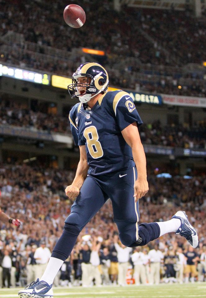 Photo - St. Louis Rams quarterback Sam Bradford flips the ball in the air after scoring on a two-point conversion to bring the Rams within a field goal of tying the game during the fourth quarter of an NFL football game, Sunday, Sept. 8, 2013 in St. Louis. (AP Photo/St. Louis Post-Dispatch, Chris Lee)  EDWARDSVILLE INTELLIGENCER OUT; THE ALTON TELEGRAPH OUT  ORG XMIT: MOSTP205