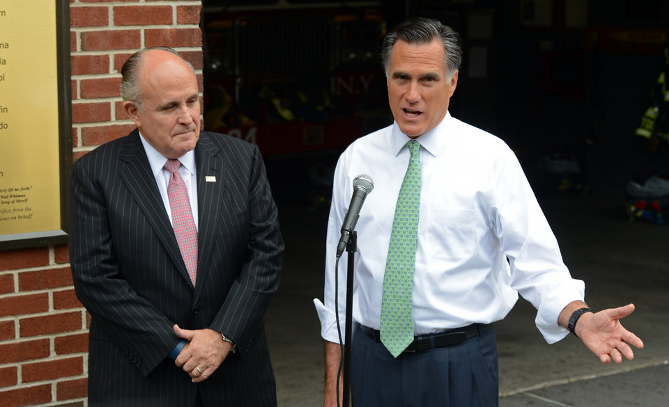 Photo -   Republican presidential candidate, former Massachusetts Gov. Mitt Romney, accompanied by former New York City Mayor Rudolph Giuliani speaks to the media after touring New York Fire Department Engine 24 Ladder 5, Tuesday, May 1, 2012 in New York. (AP Photo/Henny Ray Abrams)