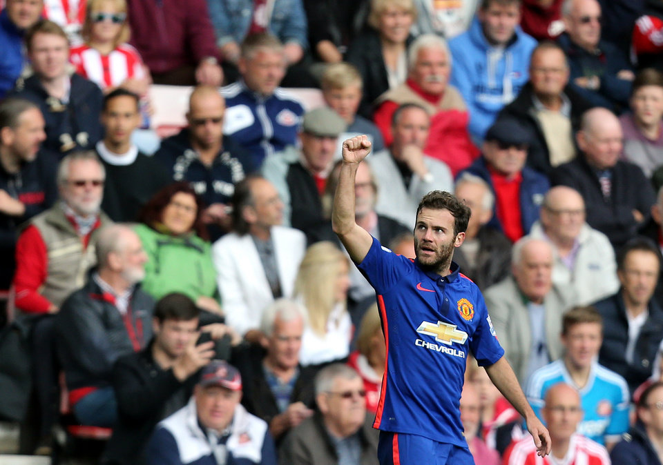 Photo - Manchester United's Juan Mata celebrates his goal during their English Premier League soccer match against Sunderland at the Stadium of Light, Sunderland, England, Sunday, Aug. 24, 2014. (AP Photo/Scott Heppell)