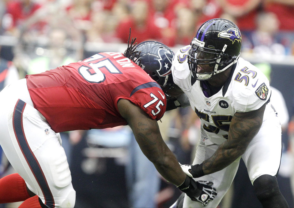 Photo -   Houston Texans tackle Derek Newton (75) and Baltimore Ravens' Terrell Suggs (55) face off during the second quarter of an NFL football game Sunday, Oct. 21, 2012, in Houston. (AP Photo/Patric Schneider)