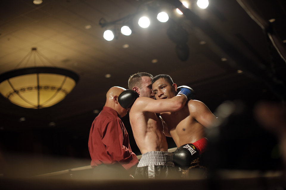 Oklahoma City's Noah Zuhdi hugs German Jurado, of Panama, after a fight for the title of WBU World Lightweight Champion at the Cox Convention Center in Oklahoma City, Thursday, Sept. 20, 2012.  Photo by Garett Fisbeck, The Oklahoman