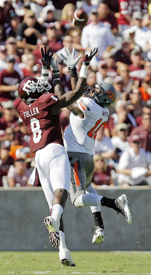 Oklahoma State's Markelle Martin (10) defends Texas A&M's Jeff Fuller (8) as he attempts to haul in a pass in the first half of their game Saturday in College Station, Texas. Photo by Nate Billings, The Oklahoman
