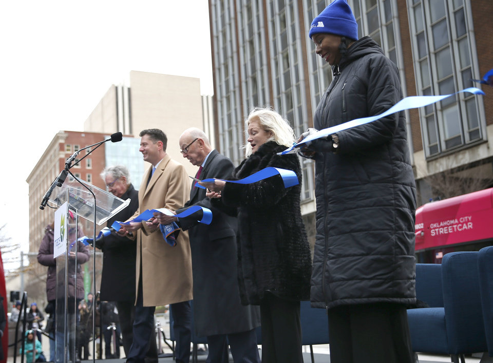 Photo - Oklahoma City dignitaries cut a ribbon during grand open ceremonies for the Oklahoma City Streetcar system at Leadership Square,  Friday, Dec. 14, 2018. Photo by Sarah Phipps, The Oklahoman