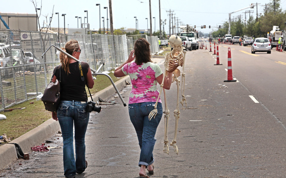 Christy Goodger and Kristin Earley, a Doctor of Osteopathic Medicinereturn with Lucy a skeleton that Earley uses in her practice that was lost in the May 20th tornado at the Moore Medical Center, Thursday, May 23, 2013. Photo by David McDaniel, The Oklahoman