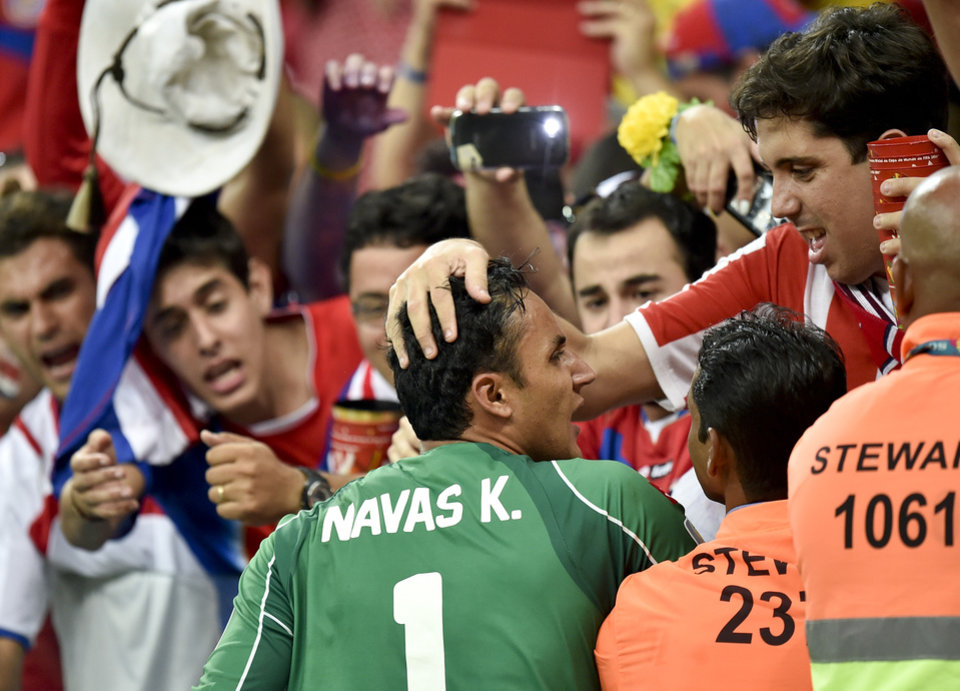Photo - Costa Rica's goalkeeper Keylor Navas is congratulated by supporters after Costa Rica defeated Greece 5-3 in penalty shootouts after a 1-1 tie during the World Cup round of 16 soccer match between Costa Rica and Greece at the Arena Pernambuco in Recife, Brazil, Sunday, June 29, 2014. (AP Photo/Martin Meissner)