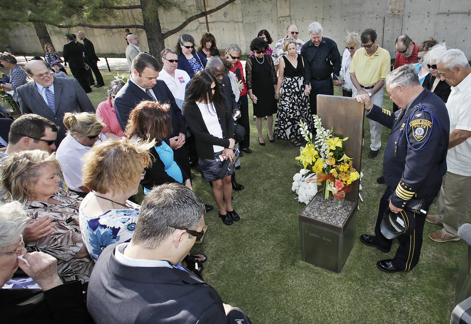 Oklahoma City Police Department Chaplain Jack Poe leads a prayer at the chair of Cynthia Brown after the Day of Remembrance Ceremony, Tuesday, April 19, 2011.  This was the 16th annual Oklahoma City Bombing Memorial ceremony.   Photo by David McDaniel, The Oklahoman