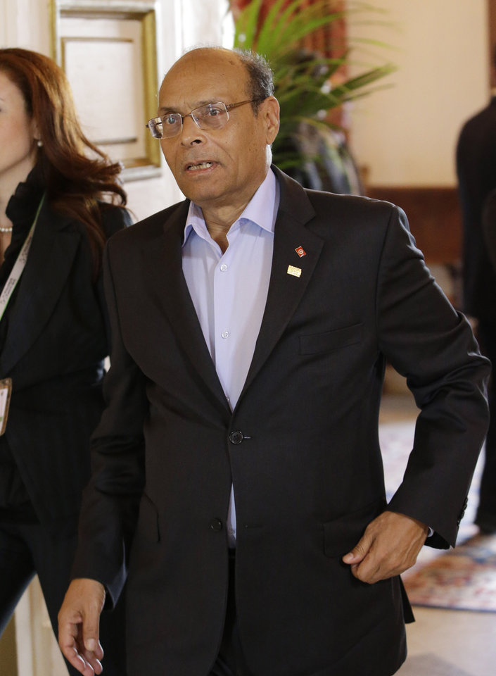 In this photo taken Saturday, Oct. 6, 2012, Tunisia's President Moncef Marzouki arrives to attend a Mediterranean summit of southern European and North African countries, in Valletta, Malta. Leaked conversations in which alcohol bans and the imposition of religious law were mentioned have raised fears Tunisia's new government may not be moderate at all, especially in the context of mob attacks on the U.S. Embassy that coincided with the American ambassador's killing in neighboring Libya. (AP Photo/Andrew Medichini)
